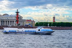 ST PETERSBURG, RUSSIA - CIRCA JUNE 2015: Meteor hydrofoil boat. On water with Rostral Columns in background stock photo