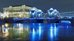Lomonosov bridge in St. Petersburg, Russia. St. Petersburg, Russia - December 24, 2017: Lomonosov bridge across Fontanka river decorated for Christmas. Built Stock Images