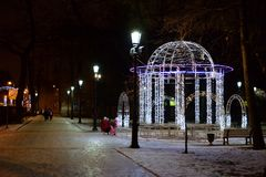 Pavilion decorated with garlands. ST.PETERSBURG, RUSSIA - 20 DECEMBER 2017: Pavilion decorated with garlands for the New Year in Petersburg at night Royalty Free Stock Photography