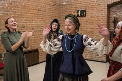 Female choral singing. St. Petersburg, Russia - December 17, 2017: A small group of middle-aged women in national costumes is taught singing with the help of a Royalty Free Stock Photos