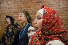 Female choral singing. St. Petersburg, Russia - December 17, 2017: A small group of middle-aged women in national costumes is taught singing with the help of a Royalty Free Stock Photo