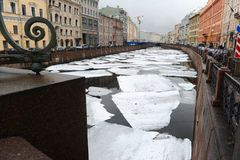ST PETERSBURG, RUSSIA. Embankment of Moika river and historic buildings in Saint Petersburg, Russia. Ice on the river.Embankment of Moika river and historic Royalty Free Stock Photos