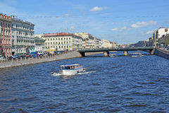 ST. PETERSBURG, RUSSIA. The excursion ships on Fontanka River near Semenovsky Bridge. ST. PETERSBURG, RUSSIA - JULY 17, 2016: The excursion ships on Fontanka royalty free stock photography