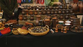 Pottery shop during the festival RECON 2017. St. Petersburg, Russia - February 24, 2017: Pottery and sourvenir shop on the festival RECON 2017. The fest includes stock video footage
