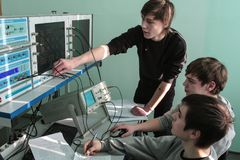 Students of Electrotechnical College in class in the laboratory stock photos