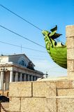 St Petersburg, Russia. Figurehead at the rostral column on the background of Old exchange building. In St Petersburg Russia. Landmarks of the Vasilievsky island royalty free stock image