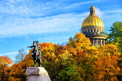 St Petersburg, Russia. Golden dome of St Isaac Cathedral and Peter the Great monument in the autumnal garden, St Petersburg, Russia royalty free stock image