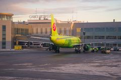 Airbus A320 of S7 Siberia Airlines on service at Pulkovo airport in the evening of January Stock Photography
