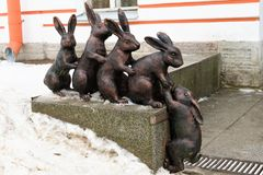 St. Petersburg, Russia, January 2, 2019. Sculptural group of bronze hares in the courtyard of the Peter and Paul Fortress. stock photo