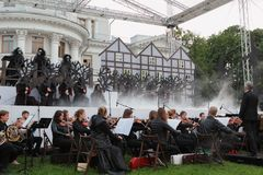 Opera The Marksman outdoors. St. Petersburg, Russia - July 19, 2017: Actors and musicians perform the opera The Marksman of C. M. von Weber outdoors during the Royalty Free Stock Photo