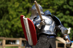 Armored knight during the battle. St. Petersburg, Russia - July 9, 2017: Armored knight fighting in the tournament during the military history project Battle On Stock Images
