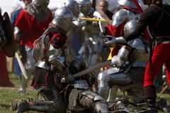 Armored knight during the battle. St. Petersburg, Russia - July 9, 2017: Armored knight fighting in the tournament during the military history project Battle On Stock Image