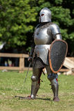 Armored knights preparing to the battle Royalty Free Stock Images