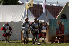 Armored knights preparing to the battle. St. Petersburg, Russia - July 9, 2017: Armored knights preparing to the tournament during the military history project Stock Images