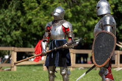 Armored knights preparing to the battle. St. Petersburg, Russia - July 9, 2017: Armored knights preparing to the tournament during the military history project Royalty Free Stock Images