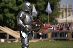 Armored knights preparing to the battle. St. Petersburg, Russia - July 9, 2017: Armored knights preparing to the tournament during the military history project Royalty Free Stock Photography