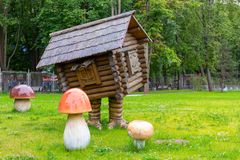 St. Petersburg, Russia - July 10, 2018: Children`s playground in the park with the character of Russian folk tales - a hut on royalty free stock photos