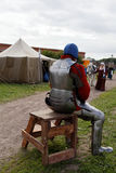 Man in plate armor after jousting tournament Stock Photography