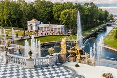 Tourists in Peterhof the fountains of the Grand Cascade Stock Photos