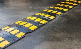 Traffic safety speed bump on an asphalt road Royalty Free Stock Image