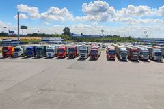 Fleet of semitrailer trucks in courtyard of logistics park. St. Petersburg, Russia - July 27, 2017: Truck fleet of trucks, a lot of trucks parked in the stock image