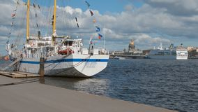 White two-masted vessel near an embankment of the Neva river in the summer Royalty Free Stock Images