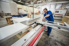 Furniture manufacturing. Processing of chipboard sheets royalty free stock photos