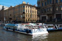 St. Petersburg, Russia - June 4 2017. Several pleasure boats on piers on Moika River. St. Petersburg, Russia - June 4 2017. several pleasure boats on the piers Stock Photo