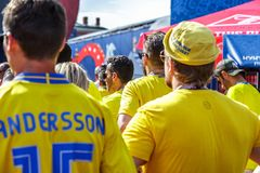 St. Petersburg, Russia - June 18, 2018: Supporters of Sweden football team, back view. St. Petersburg, Russia - June 18, 2018: Supporters of Sweden national royalty free stock photos