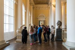 St. Petersburg, Russia - June 2 2017. tourists view sculptures in Russian Museum of Emperor Alexander III. St. Petersburg, Russia - June 2 2017. tourists view stock image