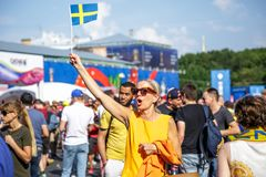 St. Petersburg, Russia - June 18, 2018: Woman supporting of Sweden national football team at FIFA World Cup. St. Petersburg, Russia - June 18, 2018: Beautiful stock photo