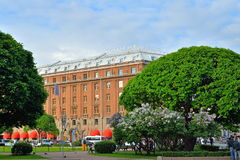 Astoria hotel amid lilac bushes on St. Isaac's square in Saint-P Royalty Free Stock Photography