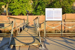 The ladder to the floating dock on the Neva river at the Admiral Royalty Free Stock Images