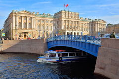 Mariinsky Palace and blue bridge over the Moika river in Saint-Petersburg stock photo