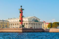 St Petersburg Russia landmarks of Vasilievsky island spit. Rostral column and old stock exchange building Royalty Free Stock Photography