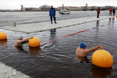 Winter swimming competitions Stock Photos