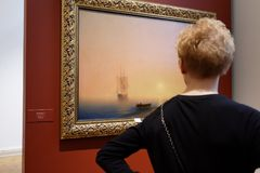 Exhibition of Aivazovsky in Russian Museum. St. Petersburg, Russia - March 21, 2017: Visitor in the exhibition of Ivan Aivazovsky in the Russian Museum. More Royalty Free Stock Photo