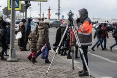 The surveyor with the theodolite makes measurements in the cente. St. Petersburg, Russia - March 28, 2018: A young male surveyor makes the necessary measurements Stock Images
