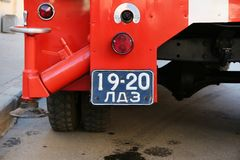 Element of the back of the old Soviet red fire truck. St. Petersburg, Russia - May 01, 2019: element of the back of the old Soviet red fire truck with a black royalty free stock photo