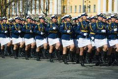 Female soldiers on the rehearsal of the military parade in honor of the Victory Day. ST PETERSBURG, RUSSIA - MAY 06, 2018: Female soldiers on the rehearsal of stock photos