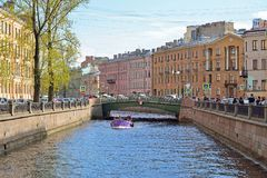 Lilac boat sails on the Canal in St. Petersburg. ST.PETERSBURG, RUSSIA - MAY 19, 2017:  Lilac boat sails on the Canal in St. Petersburg Royalty Free Stock Photo