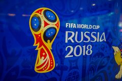 ST. PETERSBURG, RUSSIA, 02 MAY 2018: Official logo FIFA World Cup 2018 in Russia printed on a blue background, inside of. An officil shop store in St stock photos