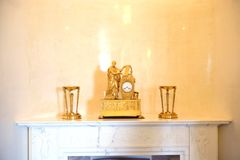 The old clock on the mantelpiece. ST.PETERSBURG, RUSSIA - 6 MAY 2017: The old clock on the mantelpiece. Fragment of interior of the Marble Palace, a branch of Royalty Free Stock Image