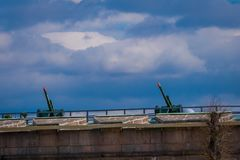 ST. PETERSBURG, RUSSIA, 17 MAY 2018: Outdoor view of two old artillery guns in a green rooftop near the Naryshkin stock image
