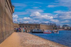 ST. PETERSBURG, RUSSIA, 17 MAY 2018: People at the beach at Peter and Paul Fortress, is one of the most populated stock image