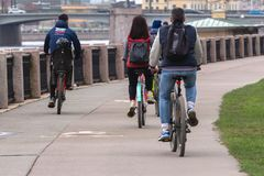 Cyclists on the waterfront. St. Petersburg, Russia - May 02, 2019: People ride bicycles along the Neva River Embankment. cyclists ride around the city royalty free stock photos