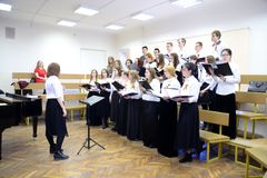 The performance of the choir. ST.PETERSBURG, RUSSIA - 5 MAY 2017: The performance of the choir indoors. Project Dancing Petersburg Royalty Free Stock Photography