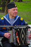ST.PETERSBURG, RUSSIA - MAY 9, 2014: pleasent veteran plays accordion on the 69-th anniversary of the victory in the World War II Stock Photos