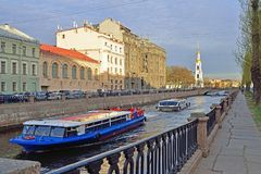 Pleasure river boats float on the Kryukov canal in the spring in Royalty Free Stock Photography