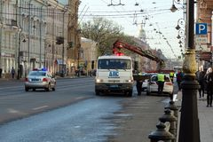 The police load a parked car on a tow truck. St. Petersburg, Russia - May 01, 2019: Police evacuate the parked car before the demonstration. Mass evacuation of royalty free stock image